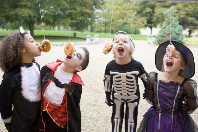 Halloween party game for kids: donut eating race